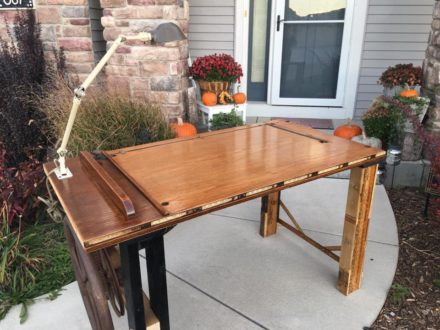 Eclectic – Table Made from Old School House Door, Corn Shucker Gears, Yardstick, Pallets and Machinist Lamp