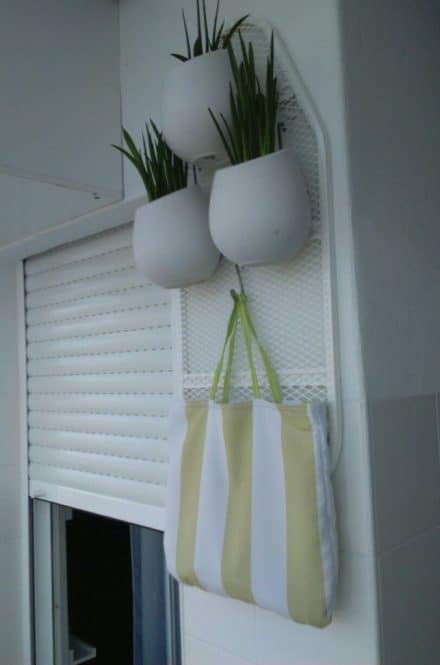 Creative Upcycled Ironing Board Plant Stand!