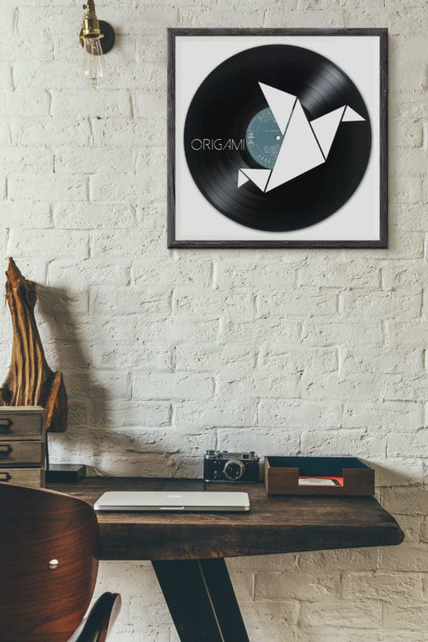 Recycled Vinyl Records include images such as this origami carving.