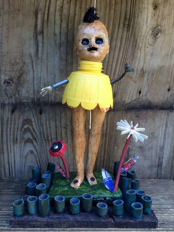 Upcycled Doll Projects - Trash into a fabulous little yard art piece using dolly parts and other bits and baubles.