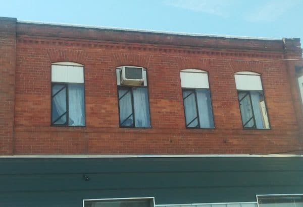 Exterior view of all four windows with new Window Screens.