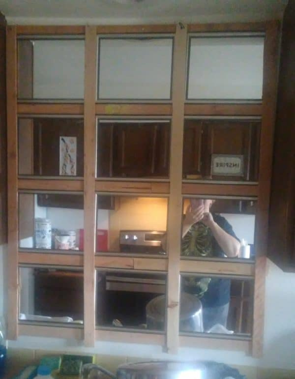 Dont wait on your landlord to fix walls. Make a Kitchen Mirror instead.