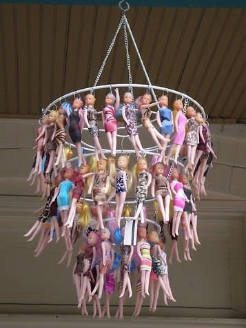 When your kid grows out of the dolls, put them to good use in a chandelier.