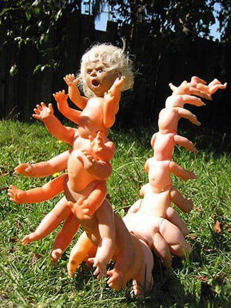 Stack babydoll bodies one on top of another, using the arms as the legs of the centipede, and you've got a creepy sculpture for Halloween 2017.