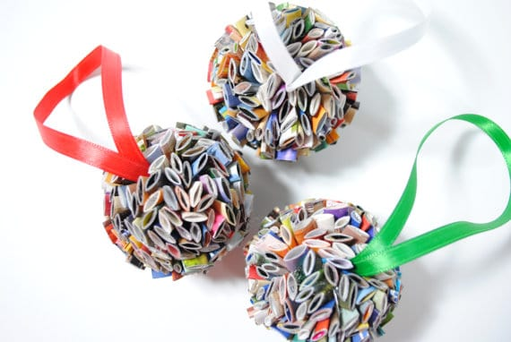 Turn magazines into holiday ornaments to upcycle while making unique Christmas Decor.