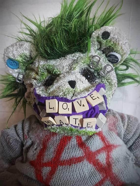"The teeth spell ""love"" and ""hate"" in this Punk Bear's mouth."