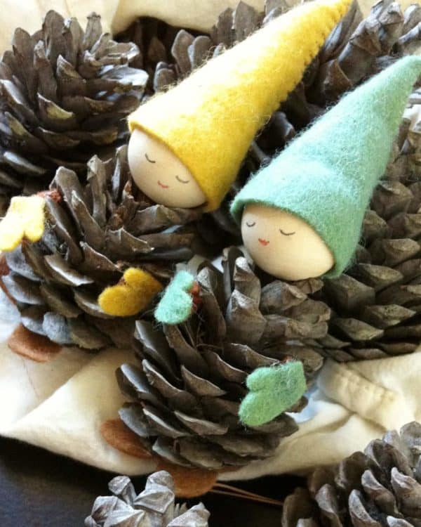 Pinecone Projects like these little pinecone gnomes are perfect for your holiday decor.