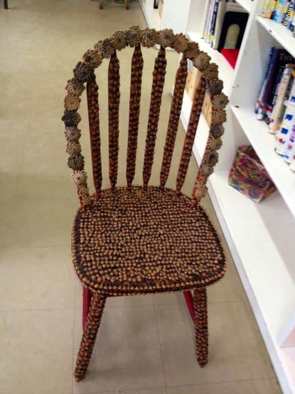 Pinecone Ideas like this chair covered with seeds and pinecone pieces just screams Christmas!
