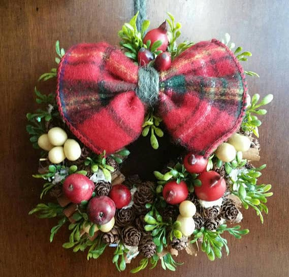 Combine fleece, pomegranates and pinecones with succulents for an inspirational Pinecone Ideas decoration.