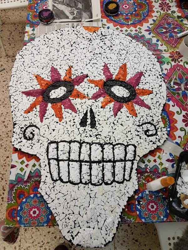 Painting the Eggshell Sugar Skull.