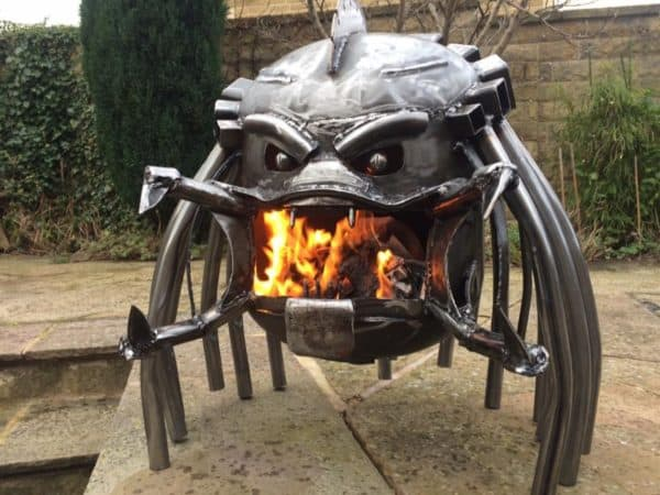 The Predator creature from the famous Predator movie series was the inspiration for one of these Upcycled Fire Pits