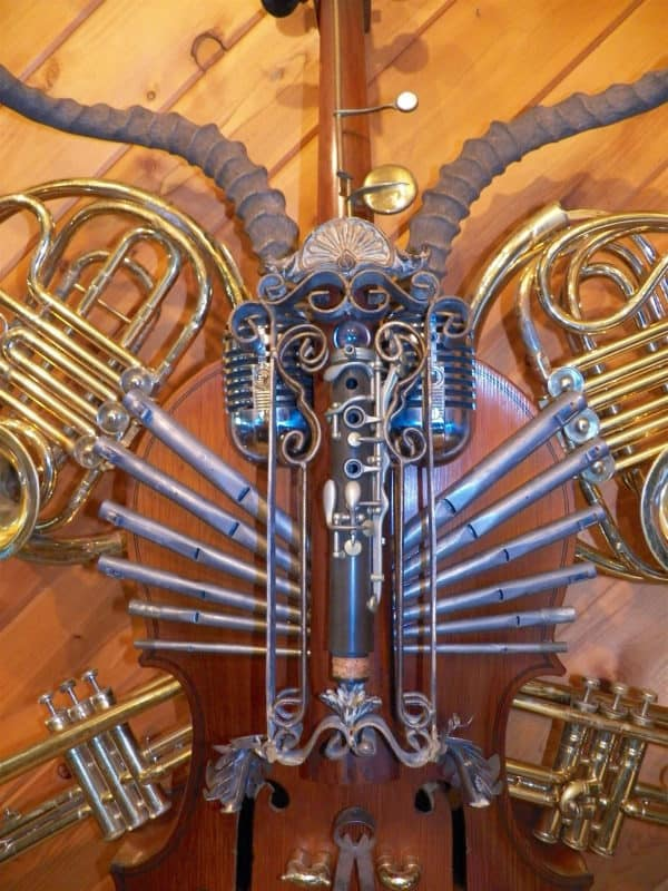 How many musically-themed items can you identify on this Nuovo Sculpture?