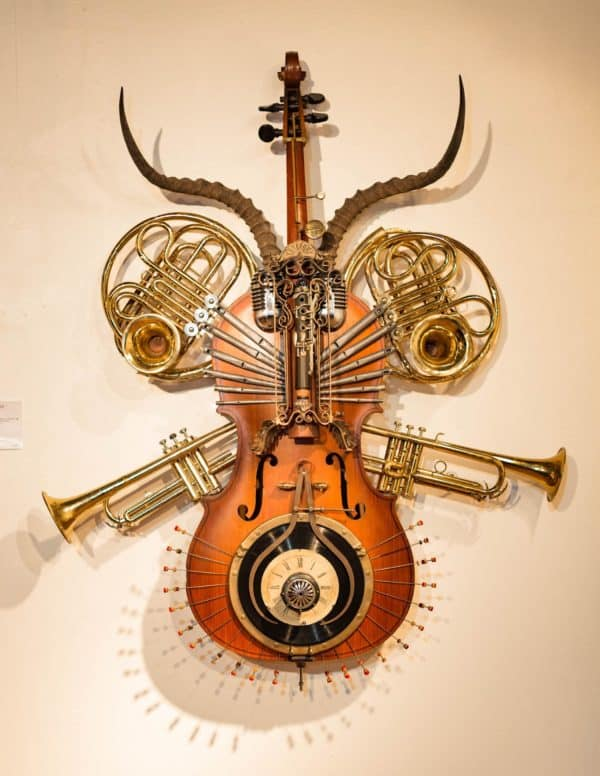 This Nuovo Sculpture has a steampunk feel with a combination of instruments and other musical-themed items.