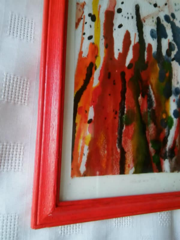 Use a bright, cheery frame to highlight your upcycled crayon art.