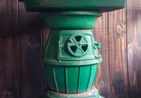 recyclart.org-recycling-a-cast-iron-stove-into-a-side-table